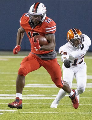 McKinley's Mani Powell gains yardage against Berea-Midpark on Friday, Oct. 9, 2020. (Special to The Canton Repository / Bob Rossiter)