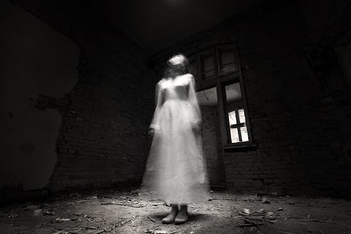 A ghostly woman dressed in white
