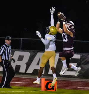 Braden River wide receiver Carson Goda pulls down a touchdown pass over Booker's Olajawon Mitchell during Friday night's game in Bradenton. DANIEL WAGNER / HERALD-TRIBUNE