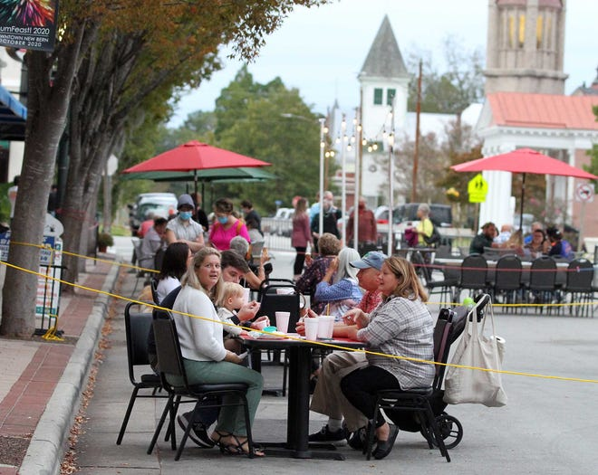 New Bern has enjoyed successful Friday and Saturday evenings dining in the streets. Here, a night of eating on the streets is paired with the city's annual MumFest/MumFeast. [Gray Whitley / Sun Journal Staff]