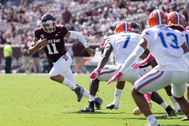 Texas A&M quarterback Kellen Mond (11) looks to run against Florida linebacker Jeremiah Moon (7) during the first quarter Saturday in College Station, Texas.