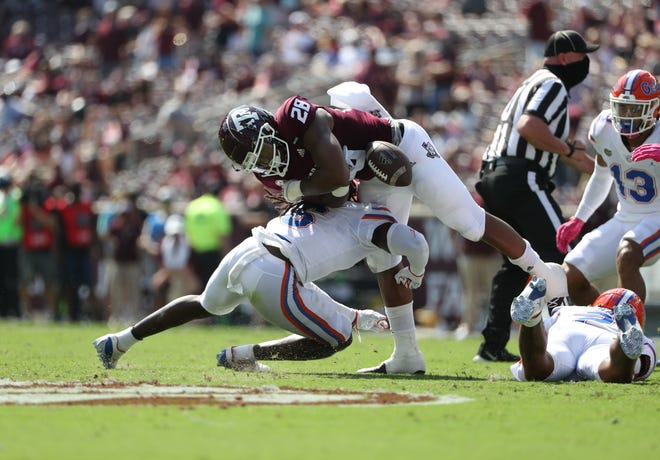 Florida defensive back Shawn Davis tackles Texas A&M's Isaiah Spiller during Saturday's game at Kyle Field in College Station, Texas.