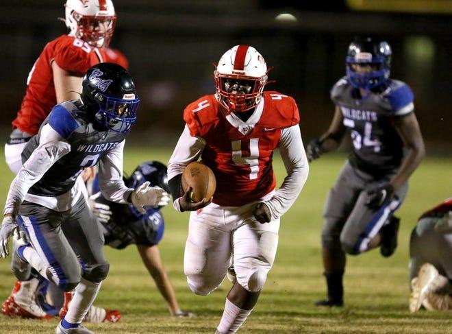 Williston running back Kurt Pitts (4) breaks away during a touchdown run against Wildwood on Friday in Williston.