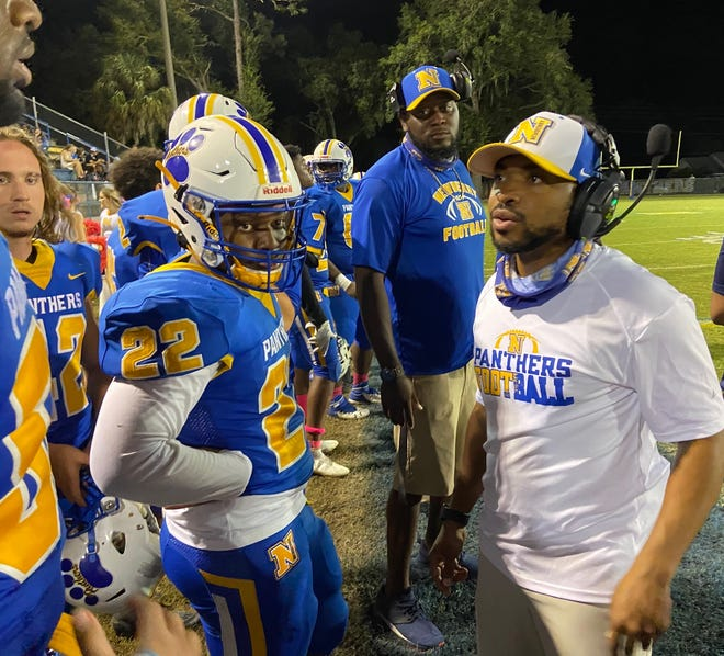 Newberry head coach Ed Johnson, right, gives instructions to his players during the second half of Friday night's home game vs. Hamilton County.
