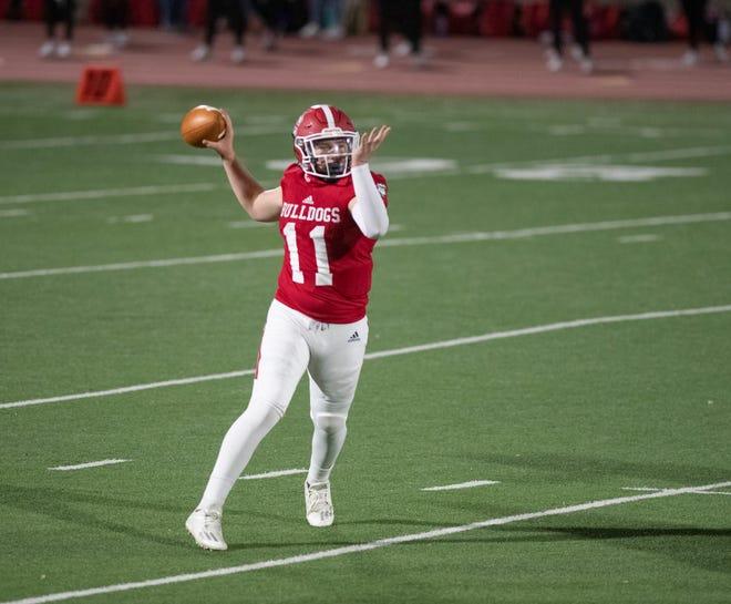 Centennial High School's Tony Cardona drops back to pass as the Bulldogs took on Canon City on Friday. [CHIEFTAIN PHOTO/ZACHARY ALLEN]