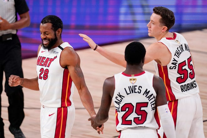 Miami Heat guard Andre Iguodala celebrates after scoring against the Lakers during the second half of Game 5 of the NBA Finals on Friday, Oct. 9, 2020, in Lake Buena Vista, Fla.