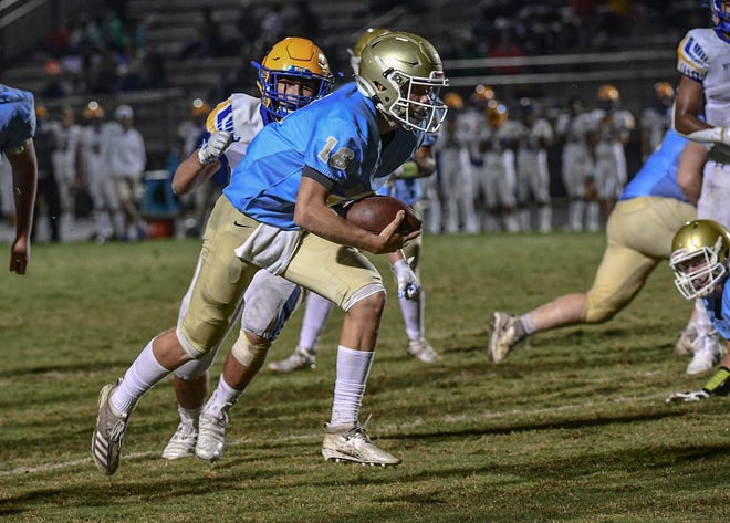 DW Daniel junior Trent Pearman runs around Wren defenders for a touchdown during the third quarter at D.W. Daniel High School in Central, S.C. Friday, October 9, 2020.
