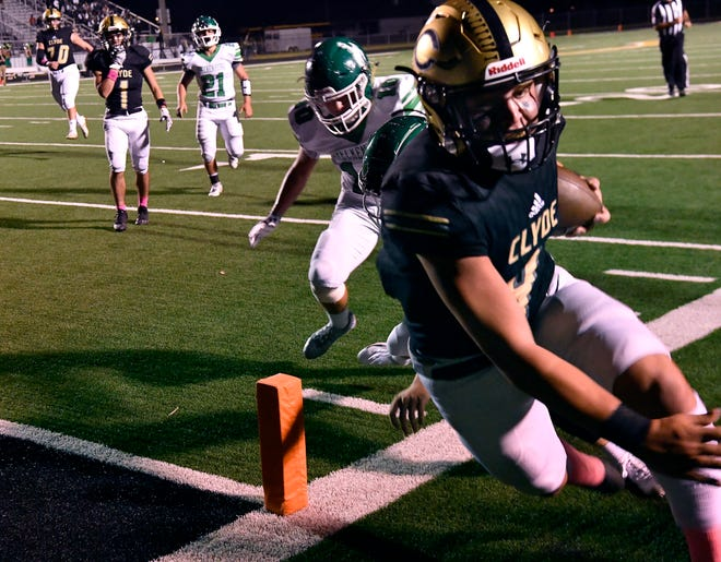 Clyde running back Nick Lopez is pushed out of bounds by Breckenridge defensive back Colby Stober inches from the goal line during Friday's game at Bulldog Stadium in Clyde.