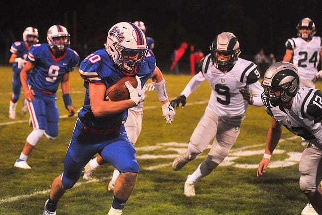 West Holmes' Brady Taylor runs for one of his huge gains against Madison. He scored four total TDs for the Knights.