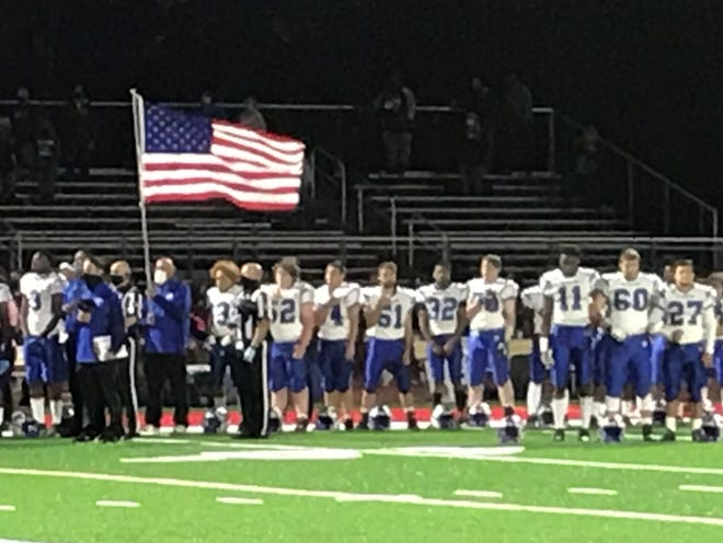 Top-ranked Williamstown stands during the national anthem during Friday's night at Kingsway. The Braves prevailed with a 13- 6 win.