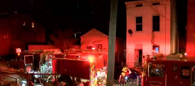 Surveillance video shows the moments a neighbor and Covington firefighters rescued a young woman and several pets, including a pig, from a house fire Friday night.