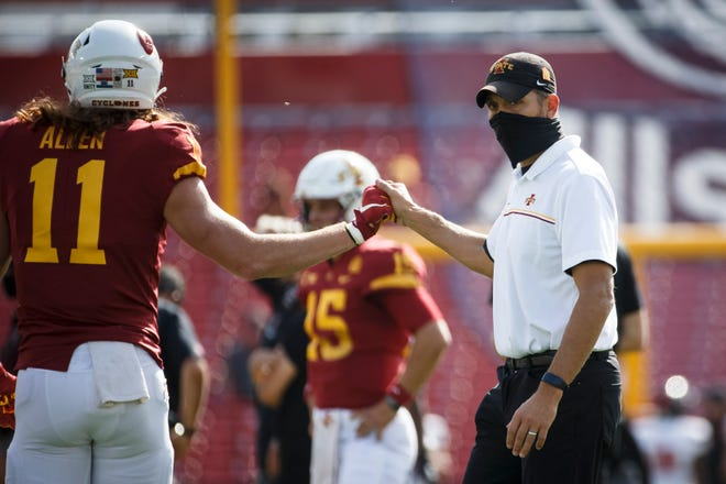 Oct 10, 2020; Ames, Iowa, USA; Iowa State head coach Matt Campbell high fives his team during warmups before their football game against Texas Tech at Jack Trice Stadium. Mandatory Credit: Brian Powers-USA TODAY Sports.