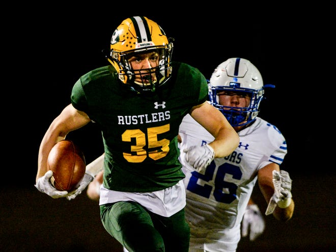 CMR's Wyatt Hagen runs with the football during during an early season football game against Gallatin High at Memorial Stadium.
