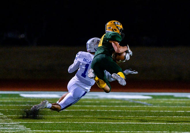 CMR's Cayden Doran intercepts a pass intended for Gallatin's Garret Dahlke during Friday night's game at Memorial Stadium.