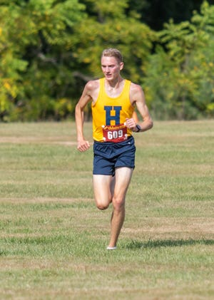 Riley Hough of Hartland ran a school-record 14:48.4 in a tri-meet at Willow Metropark.