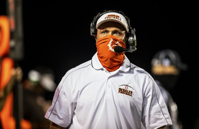 DeSales head coach Harold Davis paced the sideline as his Colts took on the St. X Tigers Friday night at Paul B. Cox Stadium.  Oct. 9, 2020