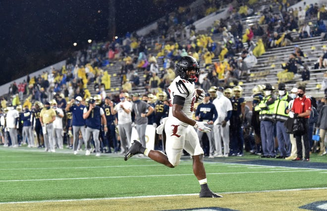Louisville tight end Marshon Ford scores a touchdown against Georgia Tech during the first half of an NCAA college football game Friday, Oct. 9, 2020, in Atlanta. (Hyosub Shin/Atlanta Journal-Constitution via AP)