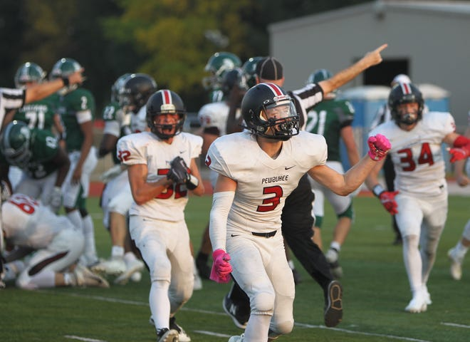 Pewaukee's Nathan Schroeder celebrates a turnover during the team's game with Wauwatosa West on Friday Oct. 9, 2020, at Pewaukee High School.