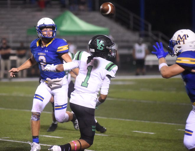 Mountain Home quarterback Bryce McKay (2) pitches the ball over Van Buren's Malachi Henry (1) to running back Gage Hershberger during the Bombers' 49-37 victory Friday night at Bomber Stadium.