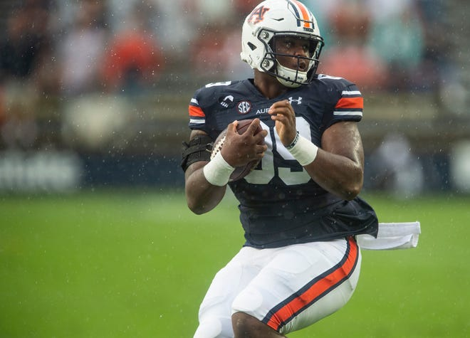 Auburn tight end J.J. Pegues (89) does a spin move as he runs the ball at Jordan Hare Stadium in Auburn, Ala., on Saturday, Oct. 10, 2020.