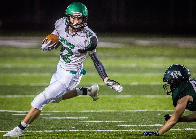 Yorktown's Alex Gibson slips past Pendleton's defense during their game at Pendleton Heights High School Friday, Oct. 9, 2020.