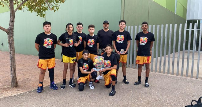 The New Mexico Xtreme basketball club poses for a photo after competing in Phoenix.