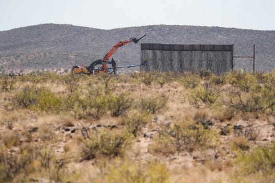 Construction crews work on the US/Mexico border wall near Columbus, N.M. on Friday, Oct. 9, 2020.