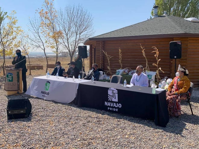 Navajo Nation President Jonathan Nez, left, speaks to Navajo Agricultural Products Industry board members and employees on Oct. 6 at NAPI headquarters south of Farmington.