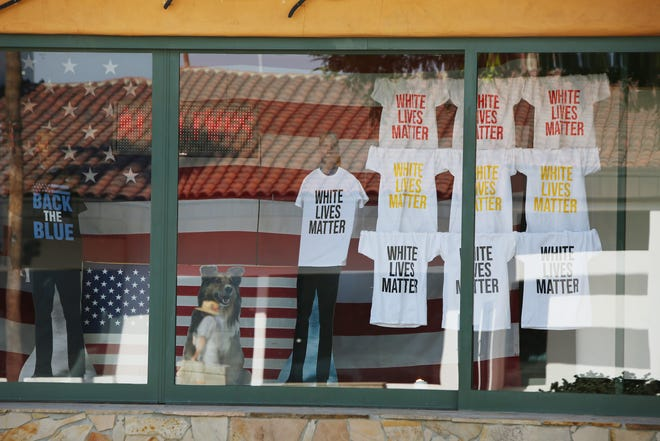 El Paseo business owner Denise Roberge is known to stir up controversy with window displays at the Denise Roberge Jewelry and Art Gallery on El Paseo in Palm Desert, Calif., as seen on Saturday, October 10, 2020.