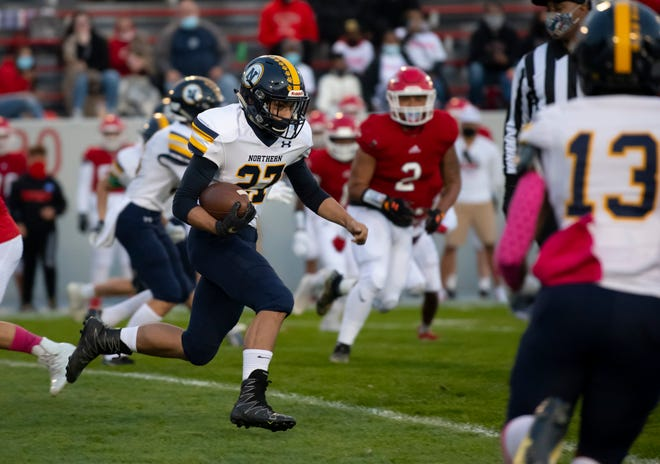 Port Huron Northern's Isaak Ullenbruch runs the ball up the field Friday, Oct. 9 during the Crosstown Showdown at Memorial Stadium.