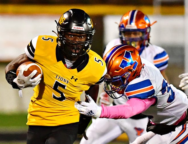 Red Lion's Jeffery Nyamekye, left, works to break away from York High's Marcellus John during football action at Horn Field in Red Lion, Friday, Oct. 9, 2020. York High would win the game 34-30. Dawn J. Sagert photo