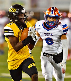 Red Lion's Jeffery Nyamekye, left, receives a pass and runs the ball for a touchdown while York High's James Bryant defends during football action at Horn Field in Red Lion, Friday, Oct. 9, 2020. York High would win the game 34-30. Dawn J. Sagert photo