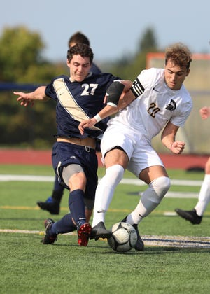 Pittsford Sutherland's Ian Bowen tries to get the ball away from Greece Athena's Dylan Rice during their game held at Pittsford Sutherland Saturday, Oct. 10, 2020.
