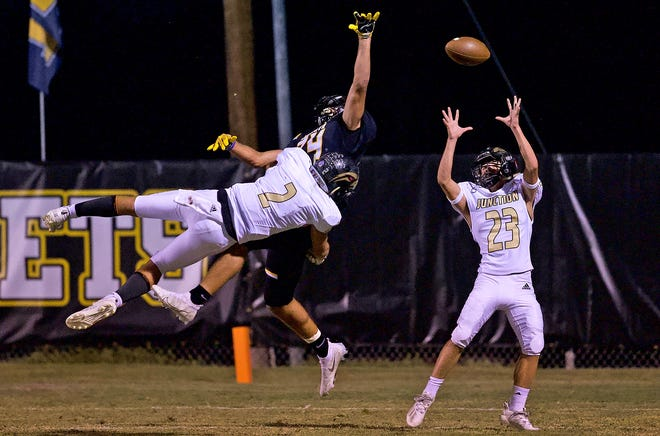 Junction High School's Will Castleberry (2) breaks up a play in the end zone while Zach Ainsworth (23) keeps his eye on a possible interception during a game against Menard on Friday, Oct. 9, 2020, in Menard.