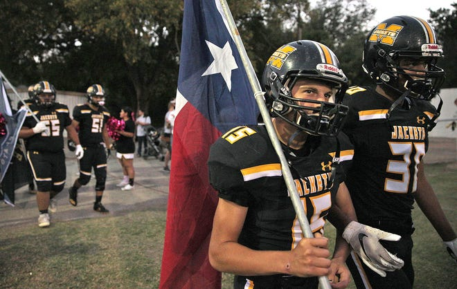 The Menard Yellowjackets take to the field before a game against Junction on Friday, Oct. 9, 2020.
