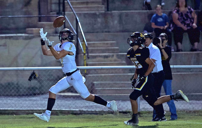 Will Castleberry, left, reaches for a catch for Junction during a game against Menard on Friday, Oct. 9, 2020.