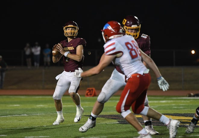 Harrisburg quarterback Jacob Knuth looks downfield in Friday's win over Lincoln