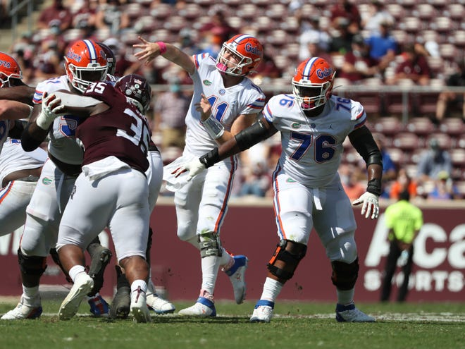Kyle Trask throws downfield during the Gators' game Saturday against the Aggies at Kyle Field in College Station, Texas.