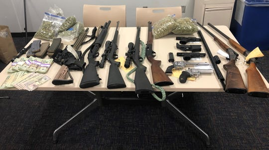 Marijuana, firearms and cash seized by Ventura County Sheriff's authorities in Maricopa.
