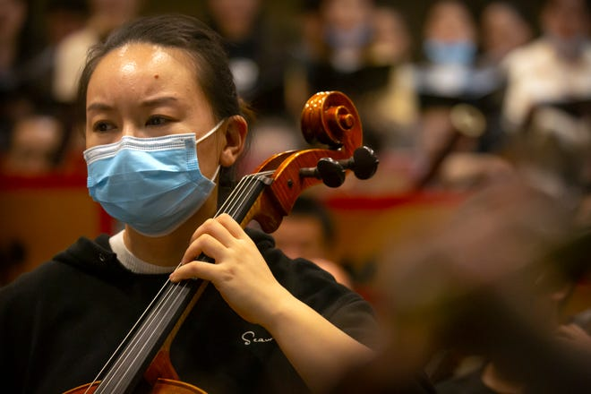 A musician from the Wuhan Philharmonic Orchestra rehearses a day before their concert to open the Beijing Music Festival, China's first classical music festival since the beginning of the COVID-19 outbreak, in Beijing, Friday, Oct. 9, 2020. China is holding its first classical music festival since the outbreak of the coronavirus pandemic featuring musicians from the global epicenter of Wuhan, in an attempt to aid in the psychological and emotional healing process.