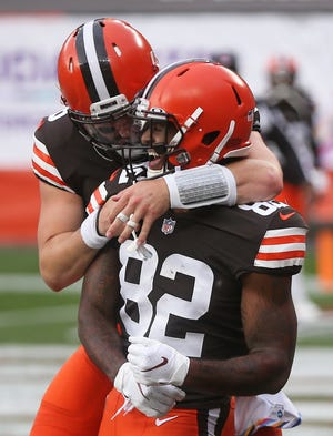 Browns quarterback Baker Mayfield, left, celebrates with Browns wide receiver Rashard Higgins after a touchdown against the Indianapolis Colts during the second quarter Sunday in Cleveland.