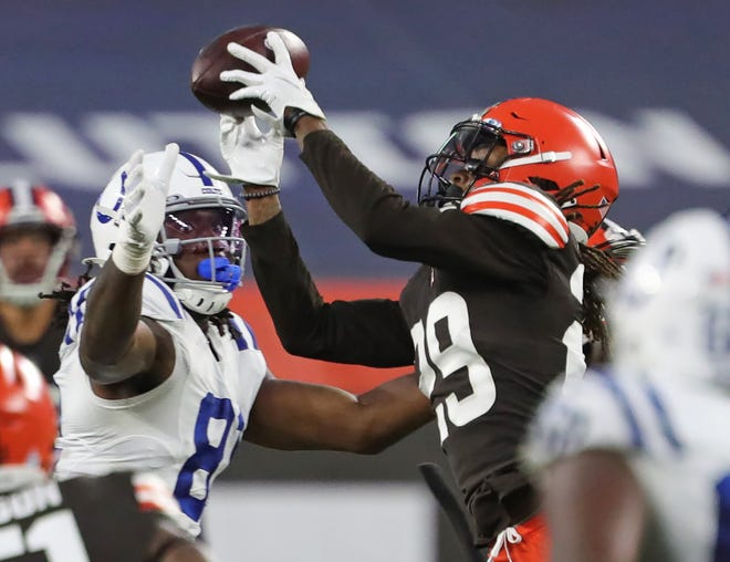 Cleveland Browns safety Sheldrick Redwine (29) picks off a pass intended for Indianapolis Colts tight end Mo Alie-Cox (81) during the second half of an NFL football game, Sunday, Oct. 11, 2020, in Cleveland, Ohio. [Jeff Lange/Beacon Journal]