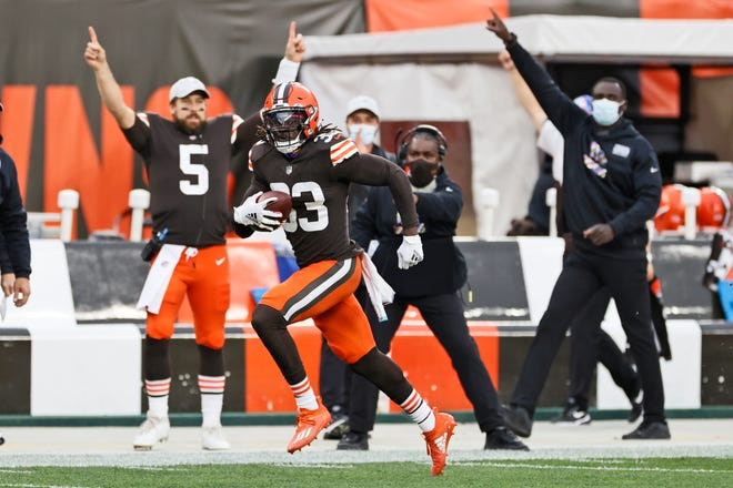 Cleveland Browns defensive back Ronnie Harrison rushes for a 47-yard interception return for a touchdown during the second half of an NFL football game against the Indianapolis Colts, Sunday, Oct. 11, 2020, in Cleveland. (AP Photo/Ron Schwane)