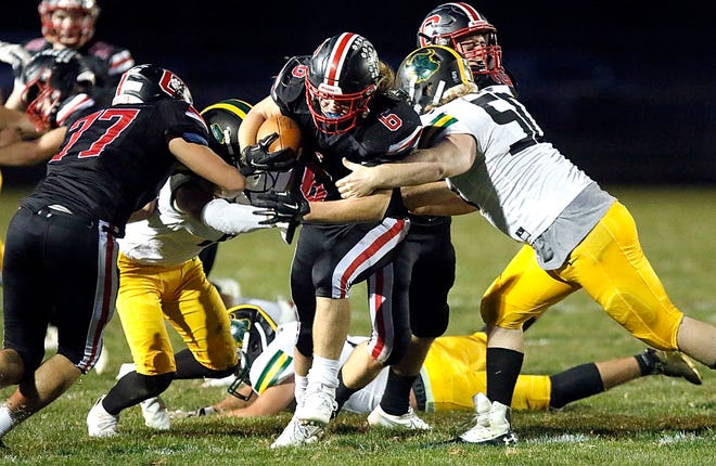 Crestview's Chase Shifflet (6) is tackled by Evergreen's Logan York (50) during their Division VI, Region 22 playoff football game Saturday night at Crestview High School's Scott Bailey Memorial Field. The Cougars won, 49-0.