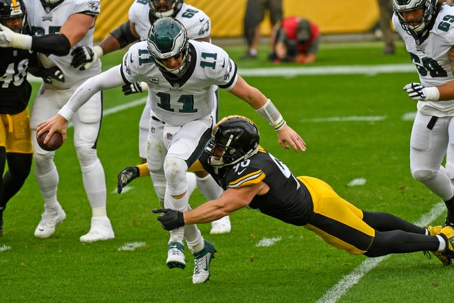 Eagles quarterback Carson Wentz is sacked by Steelers outside linebacker T.J. Watt during the first quarter Sunday at Heinz Field.