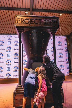 Residents get a closer look at the Project 20/70 time capsule after Saturday's ceremony in Tower Center at Unity Square.