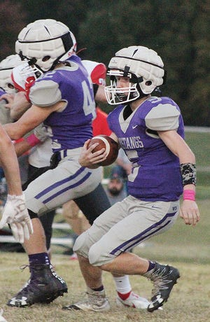Wesleyan Christian's Parker Francis, left, returns a kickoff Friday night while his brother Preston throws a block.