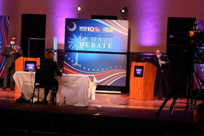 Democratic challenger Jaime Harrison, left, and U.S. Sen. Lindsey Graham, right, prepare for their debate Oct. 3 at Allen University in Columbia.