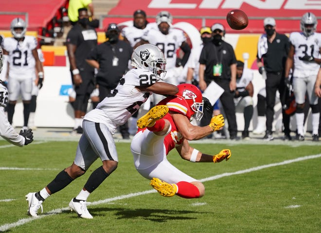 Las Vegas Raiders cornerback Nevin Lawson (26) breaks up a pass intended for Kansas City Chiefs tight end Travis Kelce (87) during the second half of a game Sunday at Arrowhead Stadium in Kansas City.