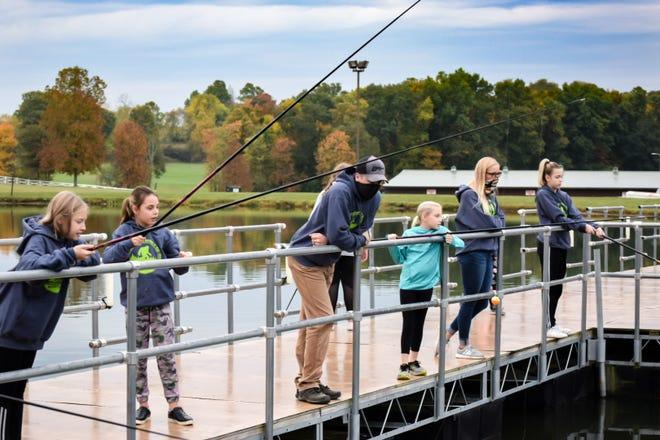 Bigfoot Lock-In attendees fish off the docks at Deerassic.